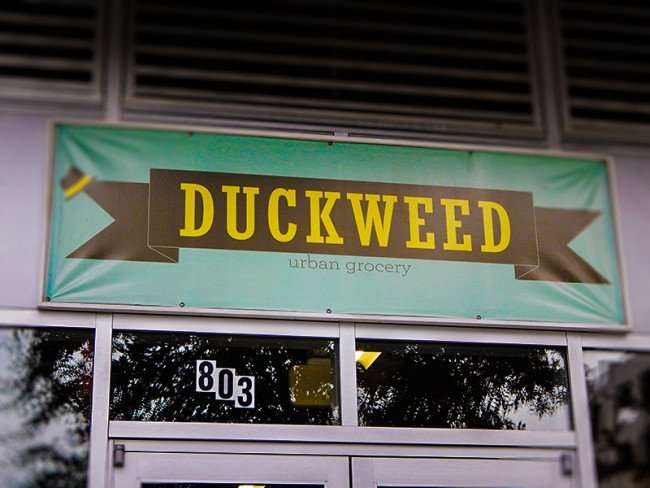 NOV 15, 2015 - Sign above front door reads DUCKWEED urban grocery at The Element apartments, Tamp, FL/photonews247.com