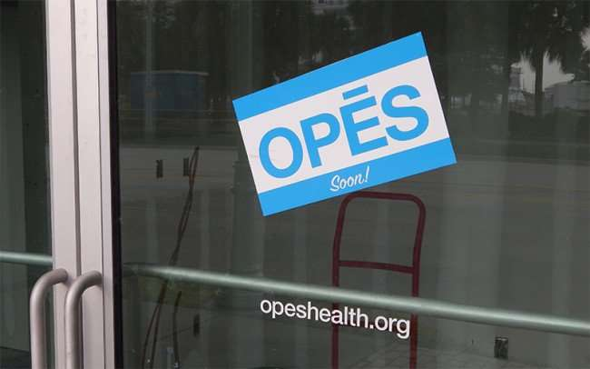 NOV 15, 2015 - Sign that reads OPES Soon on glass doors along Channelside Drive, Tampa, FL/photonews247.com