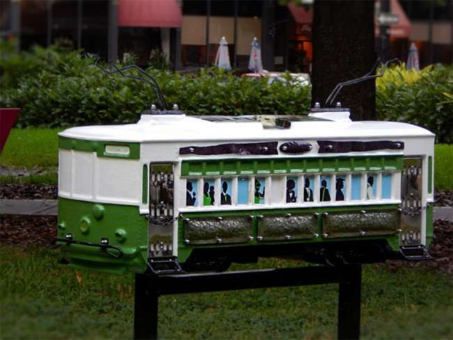 NOV 15, 2015 - Stetson Law sponsored green and white streetcar sculpture in Lykes Gaslight Park, downtown Tampa, FL/photonews247.com