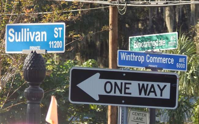 NOV 10, 2015 - Street signs Sullivan St, Bloomingdale Ave, Winthrop Commerce Ave from Boca Brandon Restaurant/photonews247.com