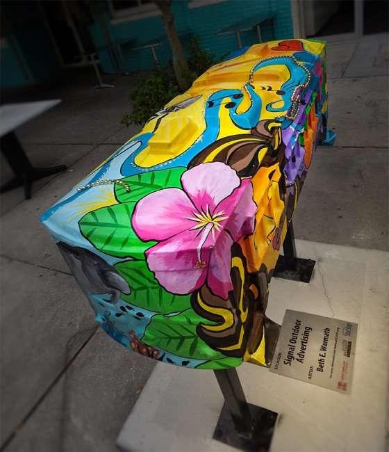 NOV 15, 2015 - Streetcar sculpture with Manatee, flowers, beads on sidewalk along Franklin St, Tampa, FL/photonews247.com