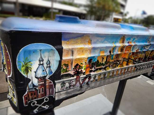 NOV 15, 2015 - Streetcar sculpture with UT and Bayshore Walk painted on side on sidewalk in Channelside Tampa, FL/photonews247.com