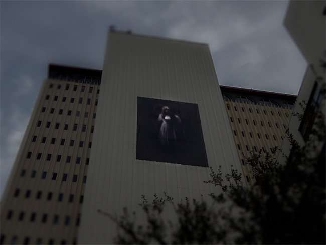 NOV 15, 2015 - Vault of Souls banner with elegant ghostly lady on side of Franklin Exchange building downtown Tampa, FL/photonews247.com