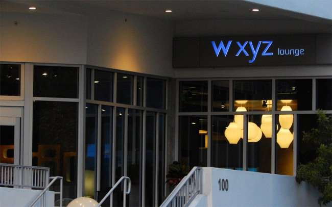 NOV 15, 2015 - WXYZ Lounge front entrance with lighted sign at aLoft Tampa Hotel on Kennedy Blvd, Tampa, FL/photonews247.com
