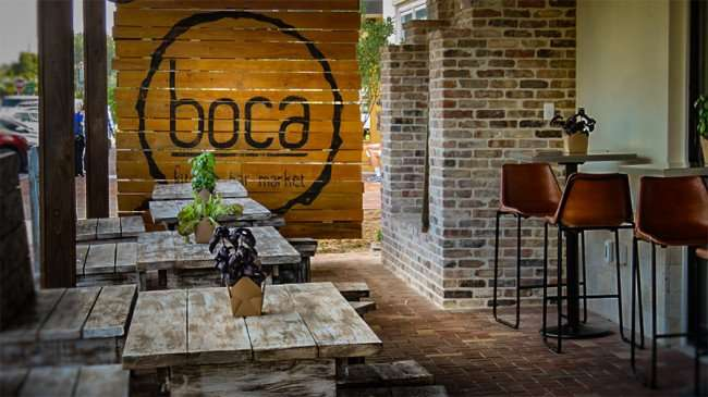 Dec 27, 2015 - boca Brandon outside dining area with attractive rustic wooden benches, Riverview, FL/photonews247.com