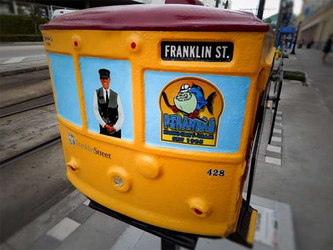 NOV 15, 2015 - yellow miniature streetcar 428 Franklin Street displayed along tracks on Channelside Dr, Tampa, FL/photonews247.com
