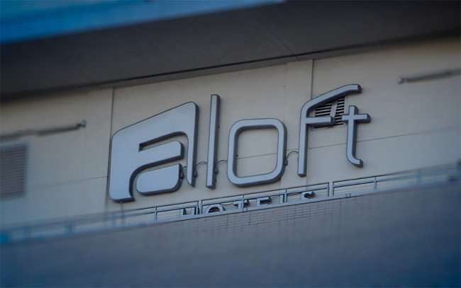 Nov 19, 2015 - Aloft logo on top of 29 story building with Strand apartments in upper half, New Orleans, LA/photonews247.com