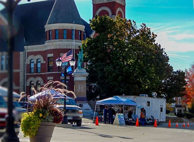 OCT 10, 2015 - Amish vender at Monroe Farmers Market next to the courthouse On The Square in Monroe WI/photonews247.com