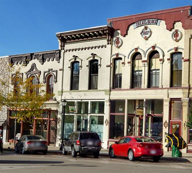 OCT 10, 2015 - Antiques Shop in building marked at top TREATS BLOCK 1872 on 16th Ave, Monroe, WI/photonews247.com