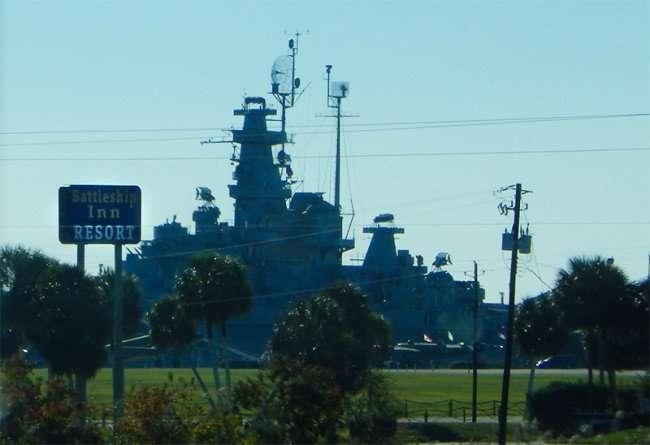 NOV 20, 2015 - Battleship INN Resort with USS Alabama Battleship in background, Mobile, AL/photonews247.com