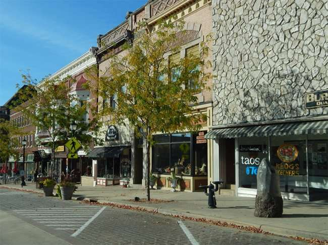 OCT 10, 2015 - Burington Shoes building on 16th Ave with drinking fountain on sidewalk, Monroe, WI/photonews247.com
