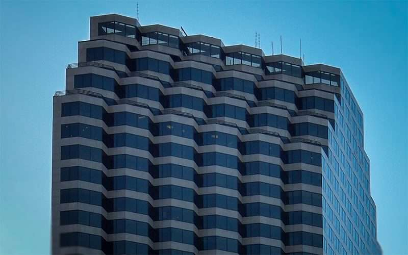 NOV19, 2015 - Energy Centre Skyscraper with tiered bay windows at top floor for aerial view of New Orleans, LA/photonews247.com