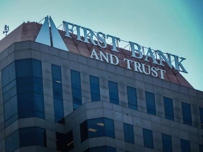NOV 19, 2015 - First Bank And Trust Tower at top with name and logo Poydras in New Orleans, LA/photonews247.com