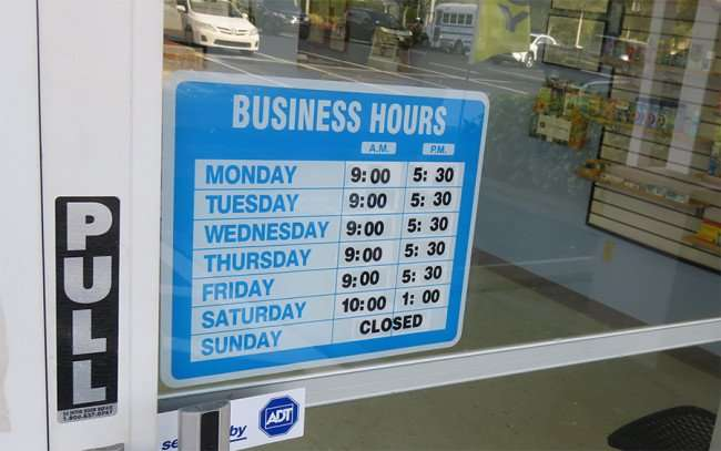 DEC 10, 2015 - Health Pro Pharmacy with hours on front door on Big Bend Road, Riverview, FL/photonews247.com