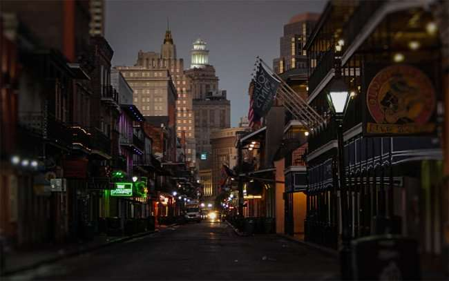 Nov 19, 2015 - Hibernia Bank Building with lighted round tower in background from Bourbon Street facing towards Canal Street in New Orleans, LA/photonews247.com
