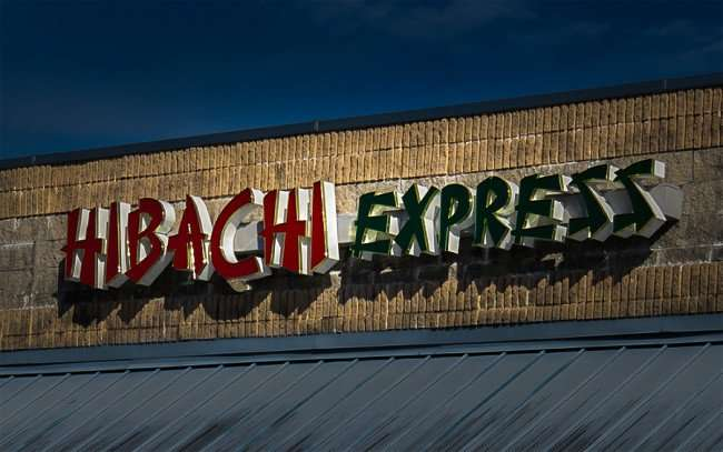 Jan 7, 2016 - Hibachi Japanese Express sign on facade at 3064 E College Ave, Ruskin, FL/photonews247.com