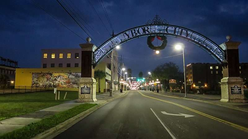 Jan 10, 2015 - Ybor City overhead sign next to future construction site (left side grassy area) of 4-story residential building Tampa, FL/photonews247.com