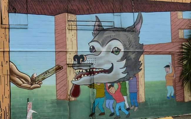 Jan 31, 2016 - Mural of villagers holding up severed dog's head as giant feeds him their stolen gold that they planned to take back and leave town for good in the Edge District neighborhood in St. Petersburg, FL/photonews247.com