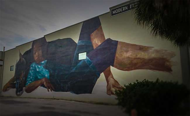 Jan 31, 2016 - Mural painting with girl and doberman pinscher on Furnish Me Vintage building, St Pete/photonews247.com