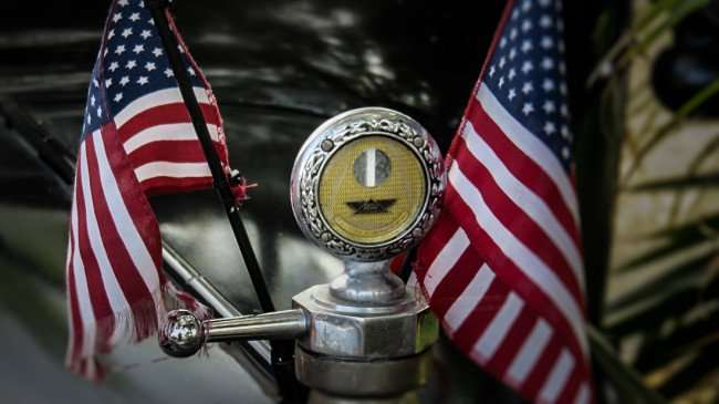 Feb 22, 2016 - Radiator cap on hood of Model T Ford with two US Flags on either side, SouthShore, FL/photonews247.com