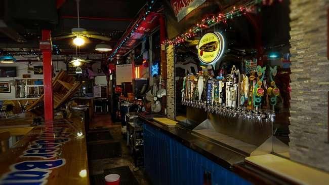 Jan 31, 2016 - Ferg's St Pete bar with taps along wall/photonews247.com