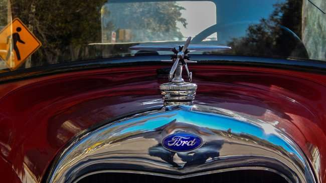 Mar 6, 2016 - 1926 red Model A Ford with propeller plane for radiator cap, St Pete, FL/photonews247.com