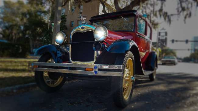Mar 6, 2016 - 1926 red Model A Ford with propeller plane for radiator cap in St Pete, FL/photonews247.com