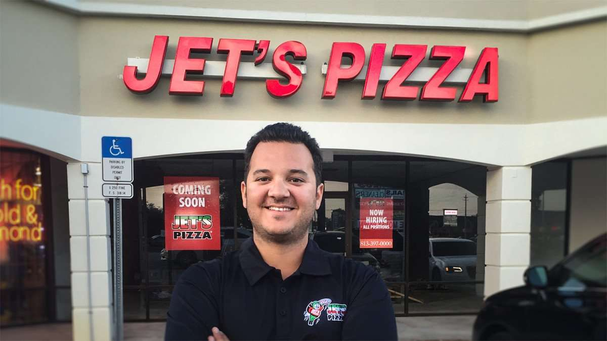 Eddie Martin, owner of Jets Pizza, stands in front of his first restaurant in Tampa FL/owner of photo Eddie Martin