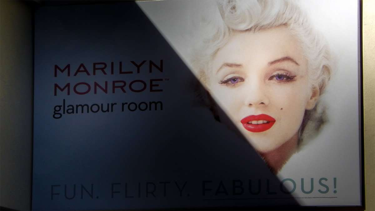 Mar 6, 2016 - Marilyn Monroe with purple eyes for glamour room ad, St Pete/photonews247.com