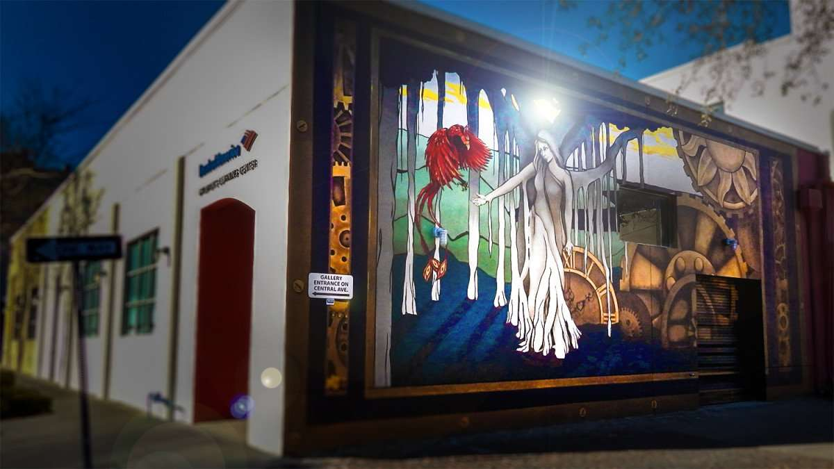 Mar 6, 2016 - Mural of animated lady and bird on back Morean Arts Center building, St Pete/photonews247.com