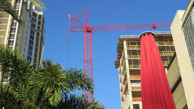 Feb 21, 2016 - Crane at Bliss condo construction site across from Parkshore Plaza condo tower on left in St. Petersburg, FL/photonews247.com FL/photonews247.com