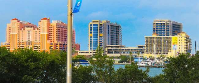 Mar 13, 2016 - Wyndham Grand Resort, the two towers with blue windows under construction in Clearwater Beach, FL/photonews247.com
