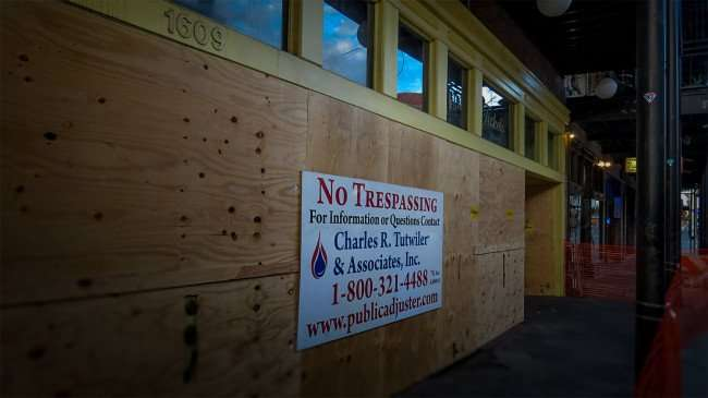 April 10, 2016 - Amphitheatre Ybor boarded due to fire with sign that reads Charles R Tutwiler & Associates Public Adjuster 1-800 231-4488/photonews247.com