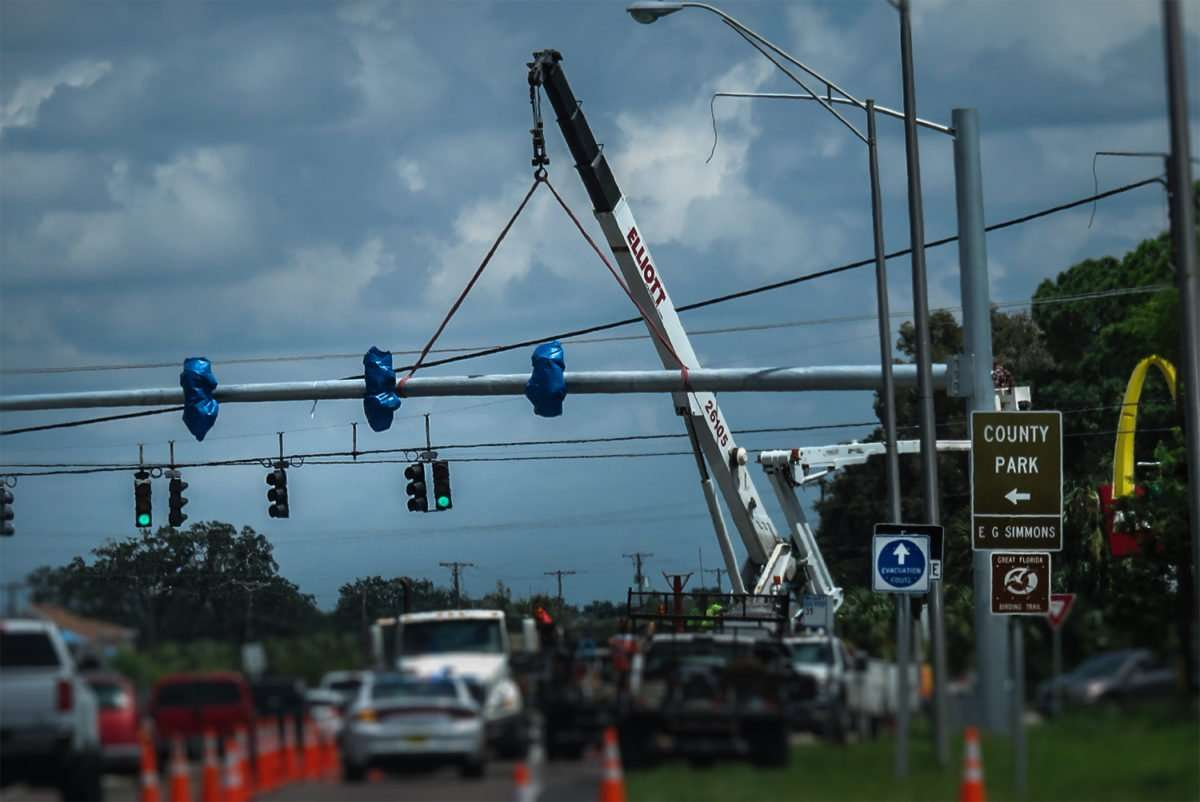Sept 6, 2016 - Crane hoisting up traffic lights at 19th Ave and US-41, Ruskin, FL/photonews247.com
