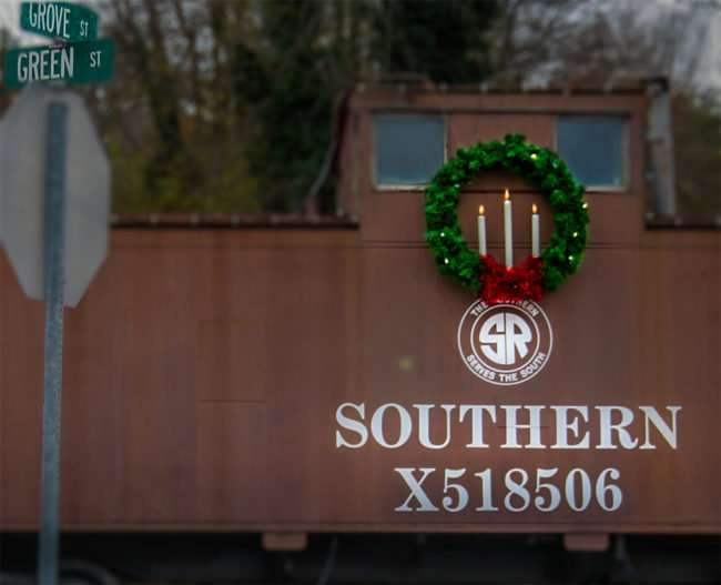 11.25.2016 - Caboose with Christmas reef at Chamber of Commerce located inan old train station at Grove and Green St, Historic District, Loudon, TN/photonews247.com
