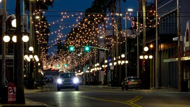 Dec 19, 2015 - 7th Ave with lights on above the street at dawn, Ybor City Tampa, FL/photonews247.com