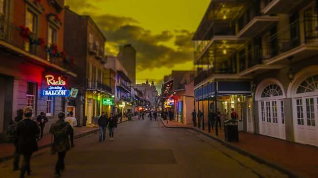 Jan 9, 2017 - Tourist walking by Ricks Sporting Saloon, Bourbon Street, French Quarter, New Orleans, LA/photonews247.com