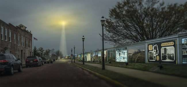 Mar 17, 2017 - Light from sky shines along floodwall with murals in Paducah KY/photonews247.com