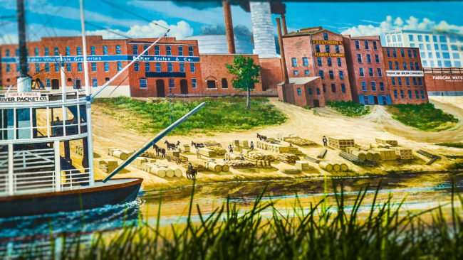 May 25, 2017 - Paducah downtown floodwall mural featuring St Louis & Tennessee River Packet Co paddle boat and Paducah Iron Co/photonews247.com