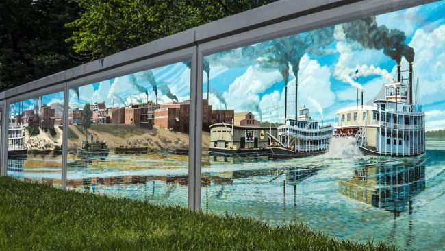 May 25, 2017 - Paducah floodwall mural with steam boats on Ohio River Downtown Paducah/photonews247.com