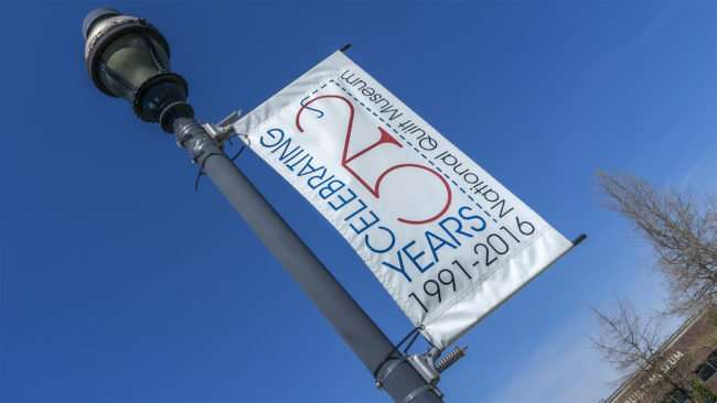 April, 8 2017 - 25th Anniversary Banner on light pole at National Quilt Museum, Paducah, KY/photonews247.com