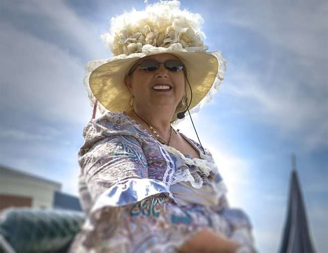 Aug 25, 2017 - Beautiful Char Diesel wearing classic Victorian dress and hat while holding sitting in the driver's seat of her horse drawn carriage in Downtown Paducah, KY/photonews247.com