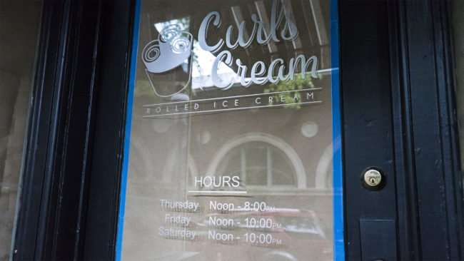 April 4, 2017 - Curls and Cream logo and hours on door, Market Square St, downtown, Paducah, KY/photonews247.com