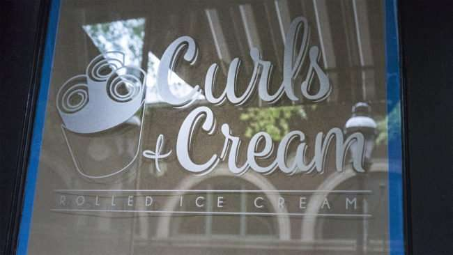 April 4, 2017 - Curls and Cream logo on door, Market Square St, downtown, Paducah, KY/photonews247.com
