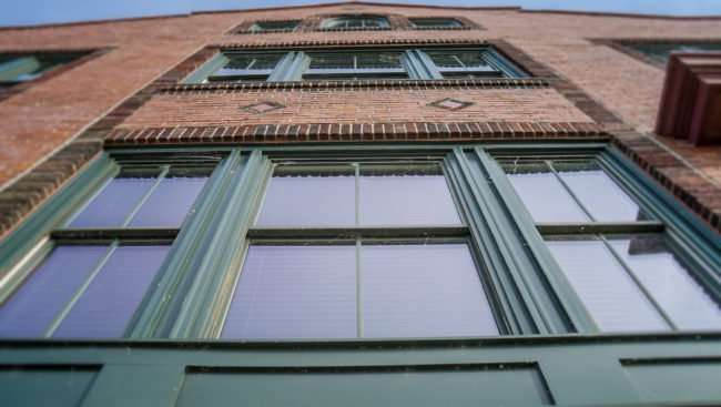 May 18, 2017 - Paducah Chamber of Commerce has green windows with red brick/photonews247.com