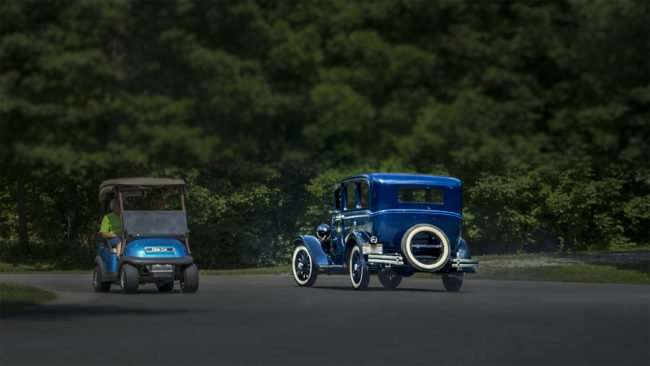 June 11, 2017 - Antique car passes golf cart while leaving Rotary Clubs 31st Super Car Show, Metropolis, IL/photonews247.com