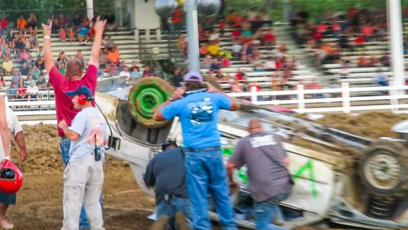 Driver celebrates with crowed after surviving car flip crash Enduro Derby McCracken County Fair