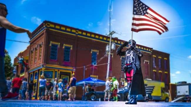 June 10, 2017 - Super Hero holding U.S. Flag on Market Street at Super Con Superman Celebration 2017, Metropolis, IL/photonews247.com