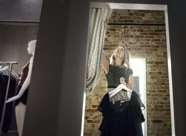 Aug 3, 2017 - Brandi McClaran, owner of McClaran Manner Fashion Boutique, fixes drapes in fitting room in Downtown Paducah, KY/photonews247.com