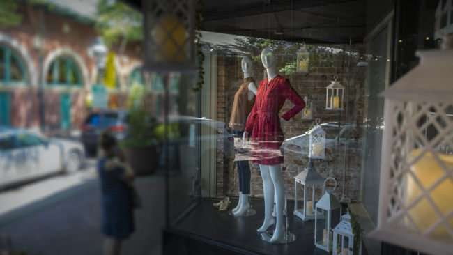 Aug 4, 2017 - Pretty Red Dress in window display at McClaran Manner Fashion women's boutique on Market House Square in Downtown Paducah, KY/photonews247.com
